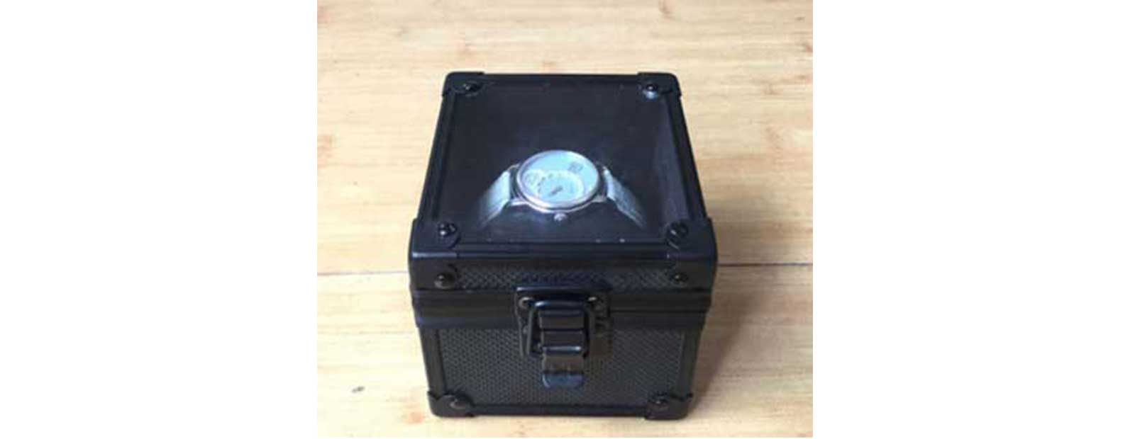 black aluminum watch case with pillow inside